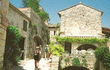 walk from famous fontaine vaucluse along the plague wall to gordes magnificent typical stone houses of provence medieval perched villages